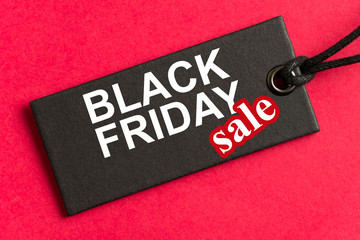 Black Friday sale tag in red background