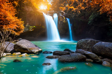 Photo sur Toile Cascades The amazing colorful waterfall in autumn forest blue water and colorful rain forest.