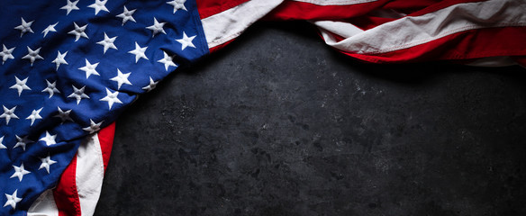 US American flag on worn black background. For USA Memorial day, Veteran's day, Labor day, or 4th of July celebration. With blank space for text. Fotomurales