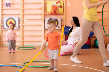 Kids with moms in gym. Healthy lifestyle and baby sport concept