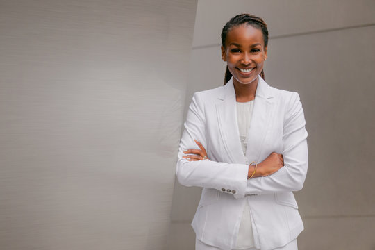 Smiling cheerful headshot portrait of an african businesswoman, corporate executive, business career professional in swanky stylish suit