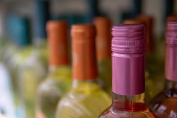 Wine bottles kept cold in a fridge