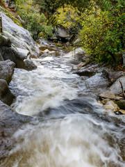 Eresma river as it passes through Boca del Asno among the granite rocks in Valsain, Segovia, Spain