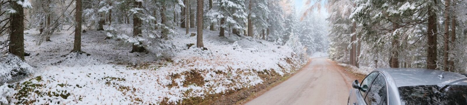 Winter road trip.Car on a winter mountain road.Gray car on the road in a winter snowy forest.Car adventure