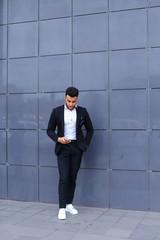 Garden Poster Fantasy Landscape Handsome arabic man talks on smart phone in business center