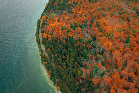 Aerial view of autumn forest in Peninsula State Park, Wisconsin. Road by the lake