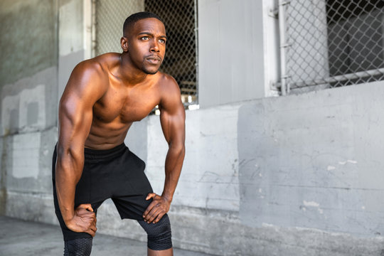 Lifestyle of african american athlete preparing for run, jogging, intense conviction, determination, serious stare, powerful eyes