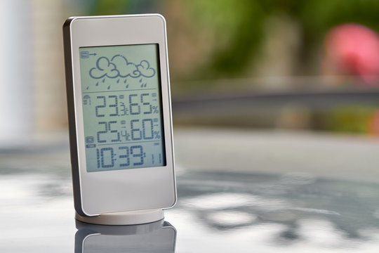 Best personal weather station device with weather conditions inside and outside. Home digital weather forecast concept with temperature and humidity.