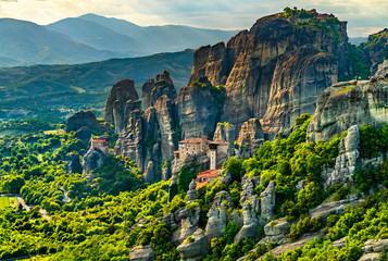 Foto auf AluDibond Blau türkis Monasteries of Roussanou, Saint Nicholas Anapafsas and Transfiguration of Christ at Meteora in Greece