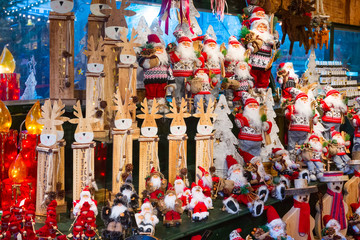 Christmas market stall with Santa Claus gifts and souvenirs for sale in Salzburg, Austria