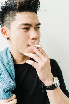 Young Asian man smoking