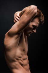 handsome sexy man posing isolated on black