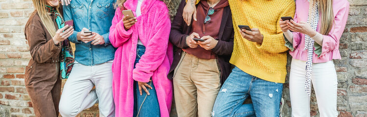 Trendy influencers friends using smartphones  - Millennials generation addiction to new technology trends - Concept of youth, commute, tech, social and friendship - Focus on hands