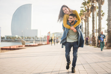 Fotobehang Barcelona Happy couple having fun walking in Barcelona - Young people enjoying time together in Barceloneta - Travel, love, youth and lifestyle concept - Focus on faces