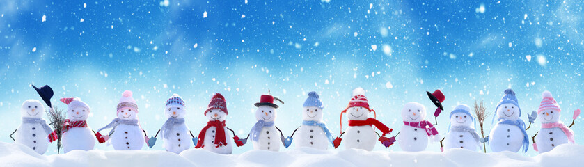 Tuinposter Pool Merry Christmas and happy New Year greeting card with copy-space.Many snowmen standing in winter Christmas landscape.Winter background