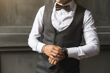 Men's three-piece wedding suit without a jacket and watch