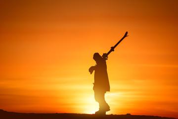 In de dag Oranje eclat Skier ski silhouette walk at sunset