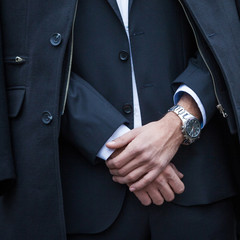 elegant man in suit and coat closeup outdoor shot