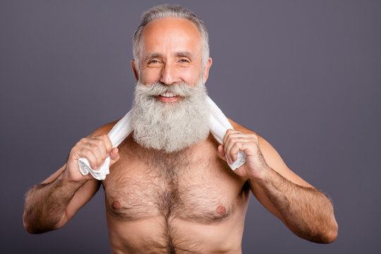 Photo of cheerful positive well cool pleased old man having washed himself with shower drying with towel isolated grey color background