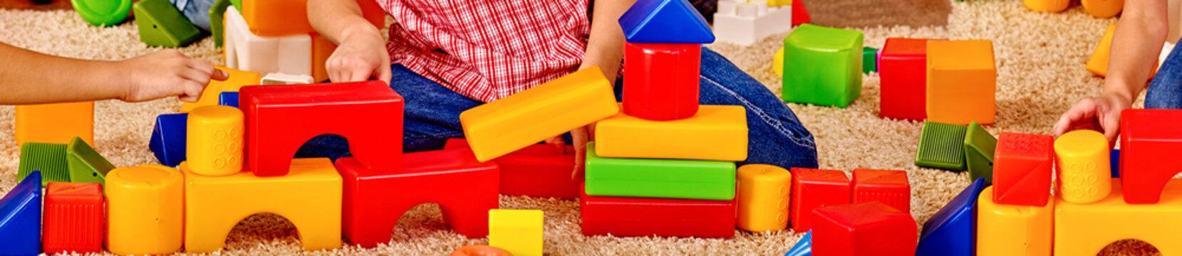 Baby cubes on horizontal long strip, banner design. Body part children hands playing in preschool.