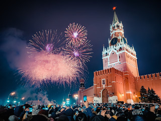 New Year's Eve in Moscow. Fireworks on Red Square near the Spasskaya Tower on New Year's Eve. Multicolored salute in the Kremlin. A large crowd of people celebrates the New Year on Red Square. Many
