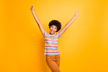 Fototapete - Photo of pretty dark skin lady overjoyed with long waited sunny summer day raising arms up going to go outside wear casual striped t-shirt trousers isolated yellow background