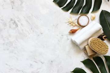 Foto op Aluminium Spa Spa massage products with monstera leaves on marble background