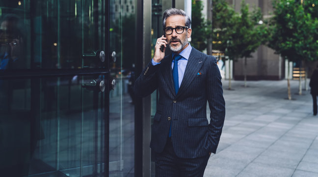 Stylish businessman talking on phone