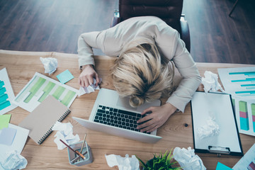 High angle above view photo of business lady head lying on desk listen online report crumple papers awful corporate situation sit chair formalwear blazer workplace office
