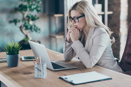 Profile photo of beautiful business lady resourceful person looking seriously notebook table watching online training minded sit chair formalwear blazer modern office