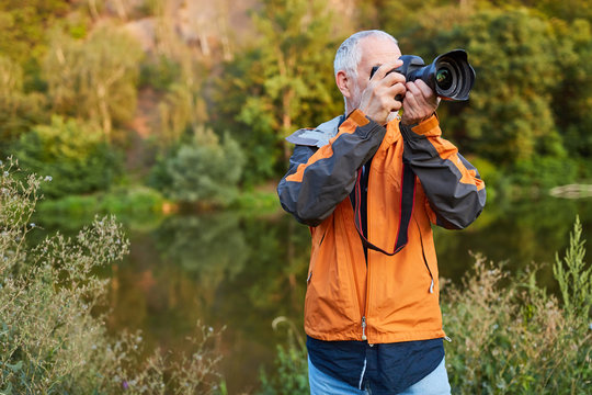 Landscape photographer in nature while photographing