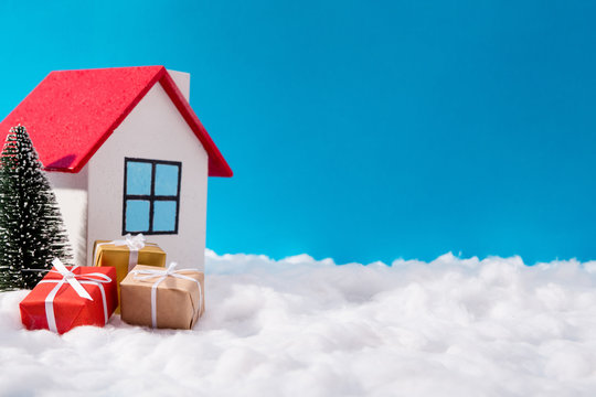 Photo of dream colorful north pole santa claus workshop house in iceland red roof surrounded by big giftboxes evergreen tree amazing fairy miniature advertisement concept