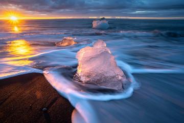 little Icebergs at sunrise in Jokulsarlon glacial lagoon. Vatnajokull National Park, southeast Iceland, Europe. Landscape photography