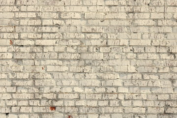 Brick wall of beige painted brick close up