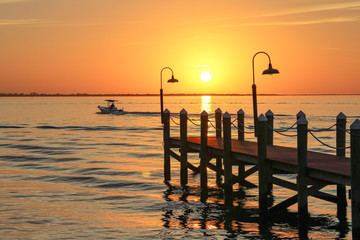 Boat leaving at Punta Rassa in Florida for Sanibel Island during sunset