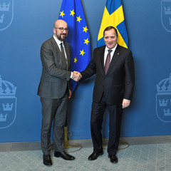 Sweden's Prime Minister Stefan Lofven shakes hands with President-elect of the European Council and former Prime Minister of Belgium Charles Michel at the Adelcrantzska House in Stockholm