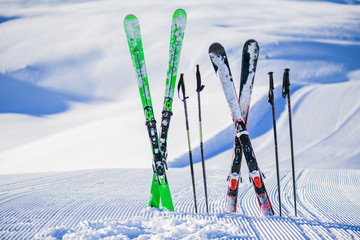 Poster Glisse hiver Skis in snow in winter season, mountains and ski items or equipments on the top in dolomites,