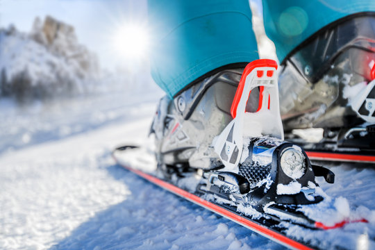 Winter skis and detailed view of the ski bindings concept in sunny day.