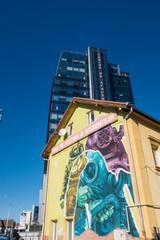 Sibiu, Romania - 5 Nov, 2019: Wall art decoration and modern offica building in Sibiu, Romania.