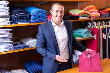 Salesman offering polo shirt