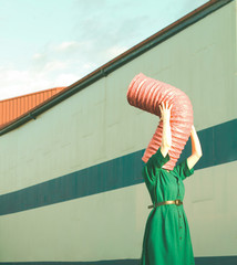Woman's face covered with pipe