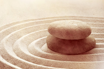 zen garden meditation stone background with stones and lines in sand for relaxation balance and...