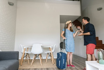 Tourist getting the key of modern vacation home from owner