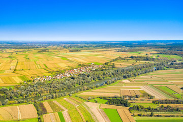 Photo Stands Melon Beautiful countryside landscape in Croatia, near Sisak, Sava river meandering between agriculture fields, aerial shot from drone
