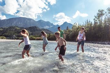 Family crossing Lech river, Allgaeu, Reutte, Tyrol, Austria
