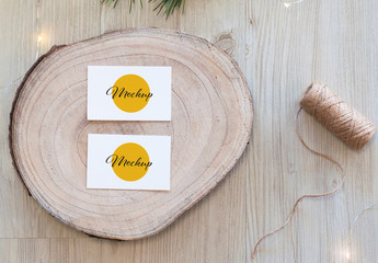 2 Horizontal White Business Card on Wood Slice Top View Mockup