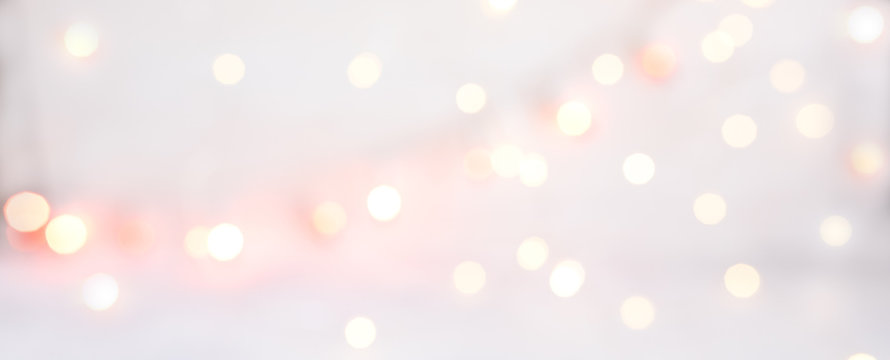 Abstract texture of bokeh christmas lights in rose. Sparkling lights product background.