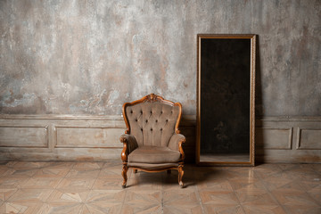 Keuken foto achterwand Retro old chair and a mirror on the background of vintage wall