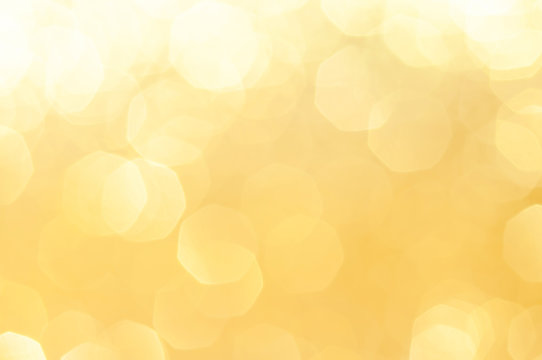 Gold,yellow abstract light background, Gold  bokeh shining lights, sparkling glittering Christmas lights.Season greeting background.New year Luxury backdrop image.Blurred abstract holiday background.