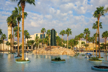 Water feature in a man made lake surrounded by palm trees, as a beauttiful landmark in Aqaba, Jordan.